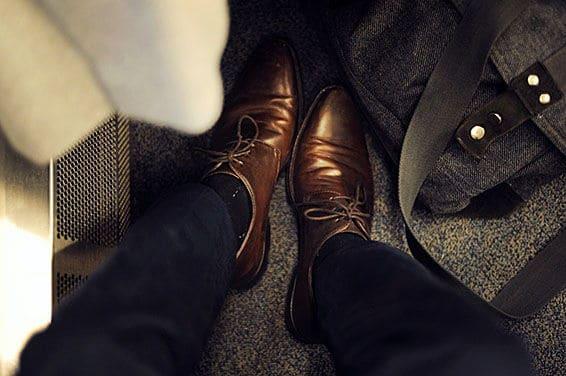 mens feet on train
