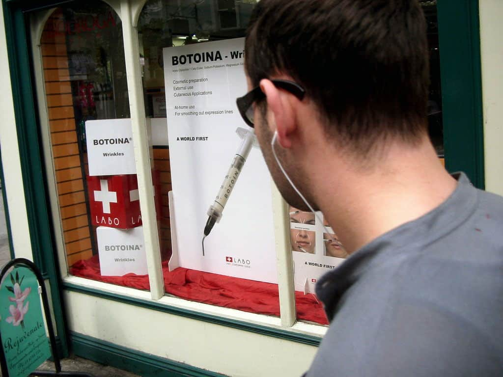 man looking at botox sign