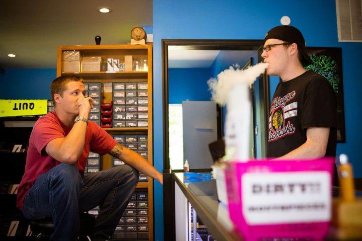 two people smoking