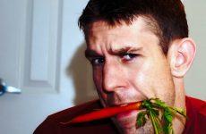 man eating veggies