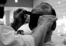 man getting haircut back