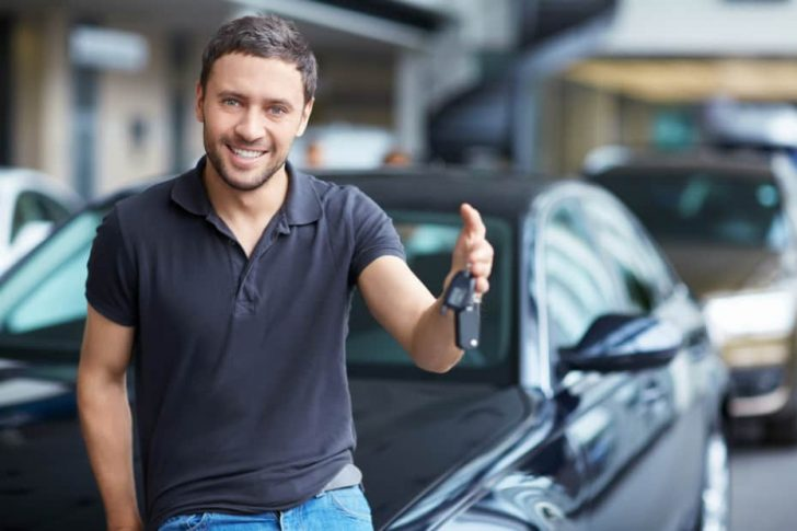 man with new car