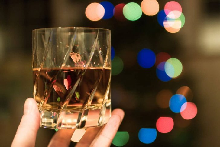 holding whiskey glass