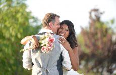 man hugging bride