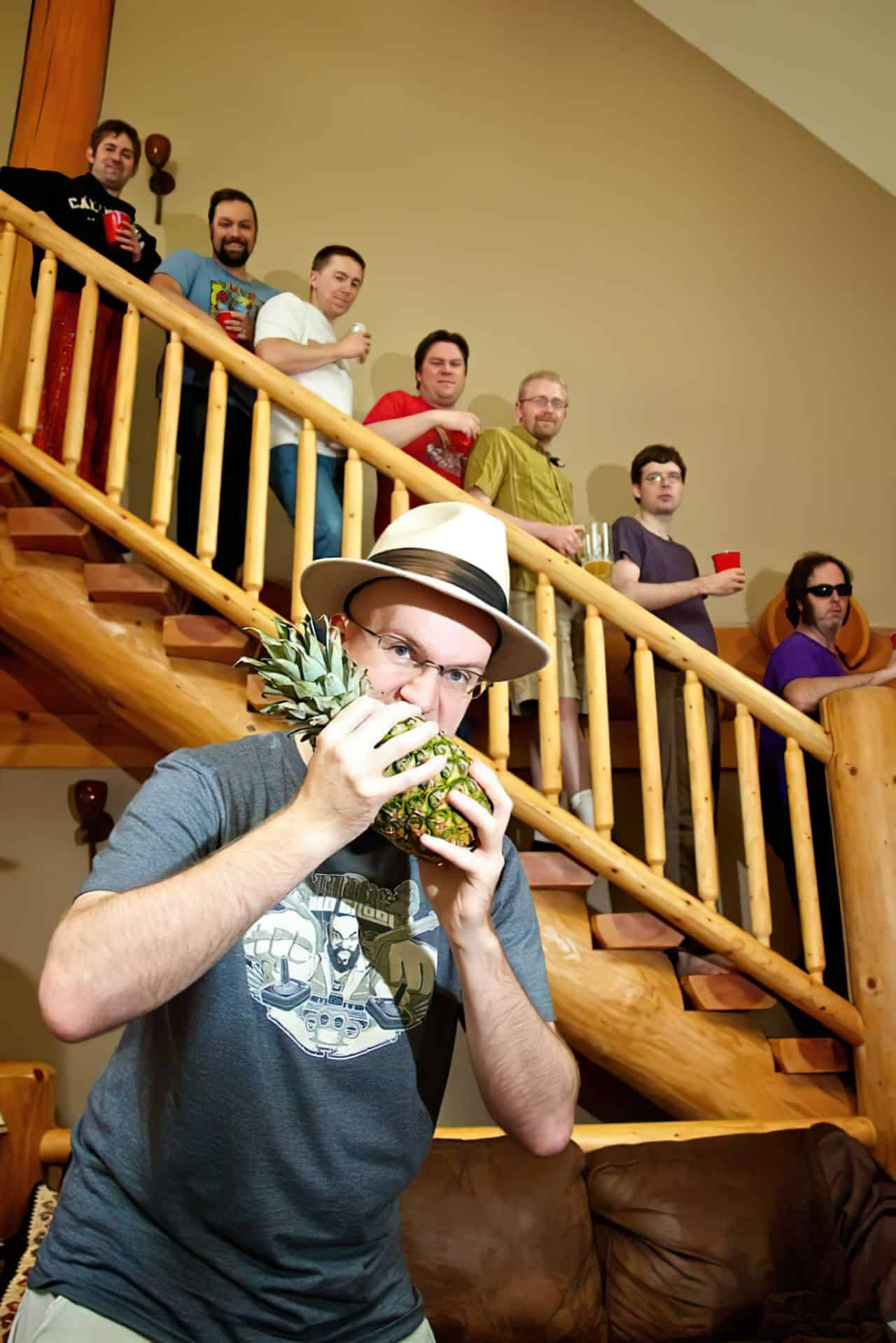 bachelor party eating pineapple