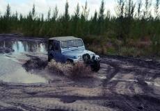 jeep driving through mud