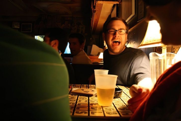 man drinking and yelling