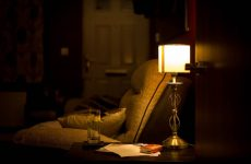 room armchair lamp evening home