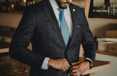 man buttoning suit