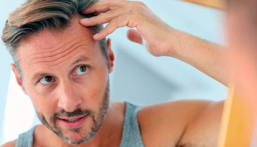 man checking hair