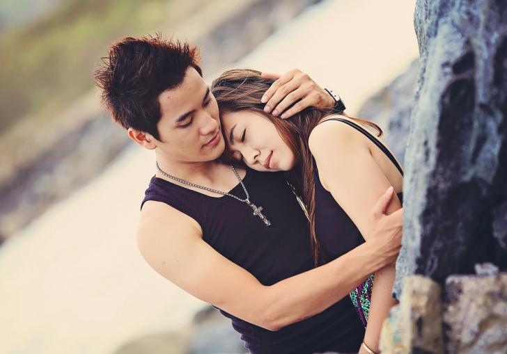 man clutching woman