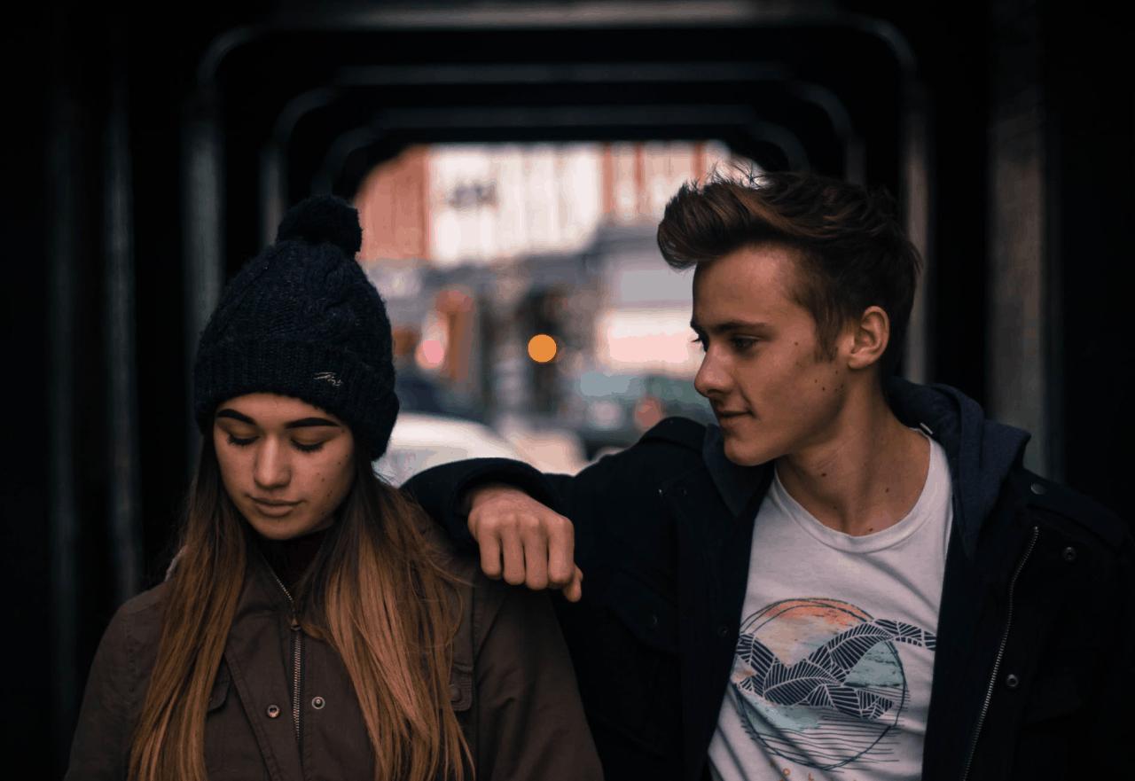 man leaning woman shoulder