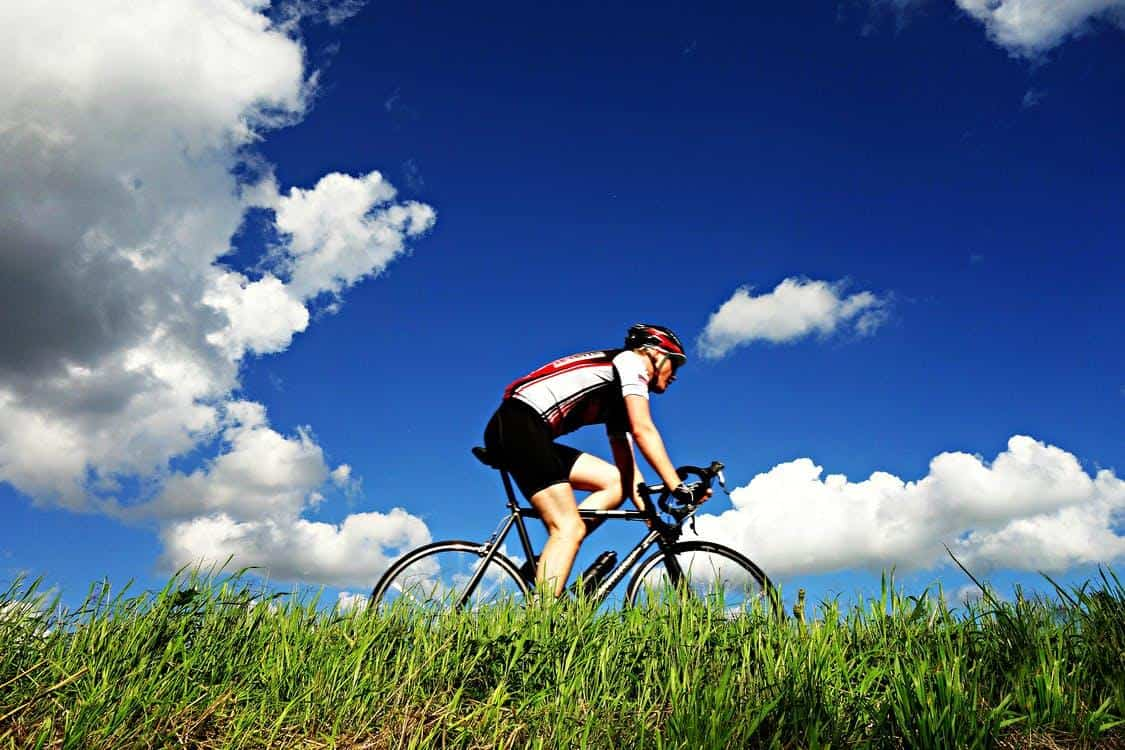 person cycling blue sky