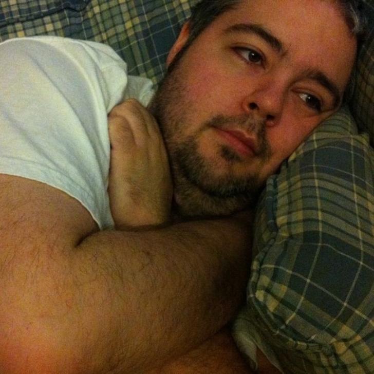 man cuddling couch