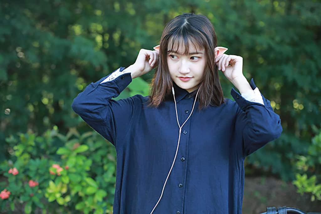 woman wearing elf ear headphones