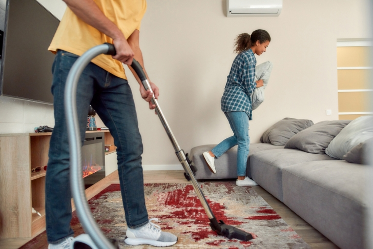 couple cleaning mess