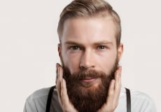 happy man touching his beard