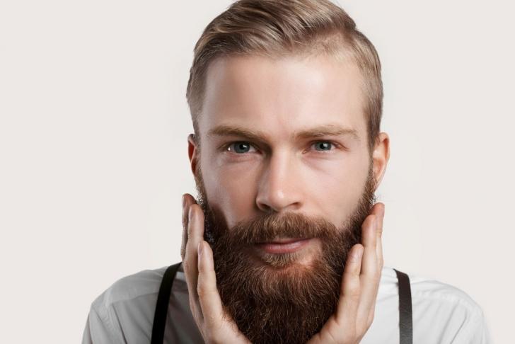 happy man touching his beard