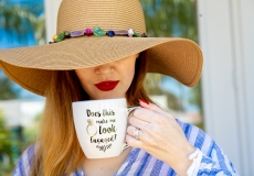 woman sipping from mug