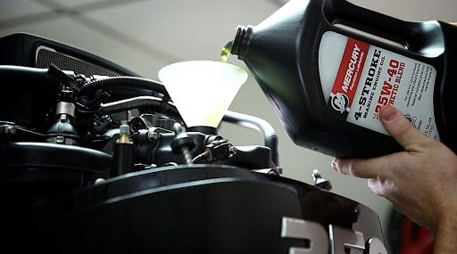 pouring motor oil into car