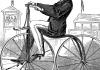 man riding penny farthing