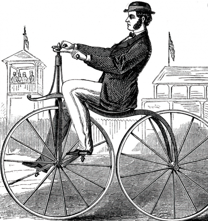man riding penny farthing