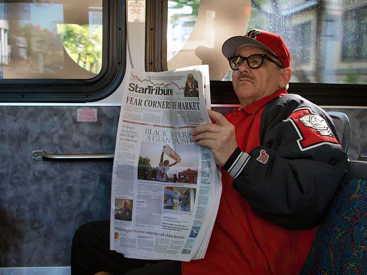 man riding the bus
