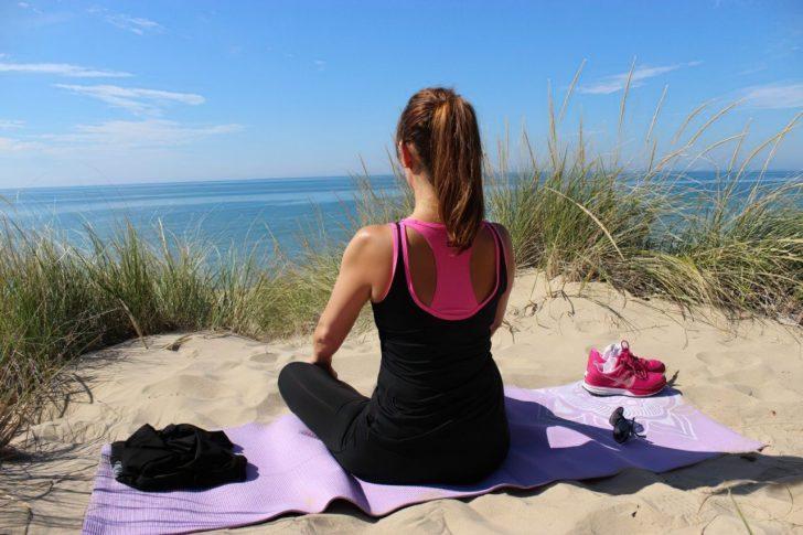 meditation yoga woman girl sand beach exercise enlarged