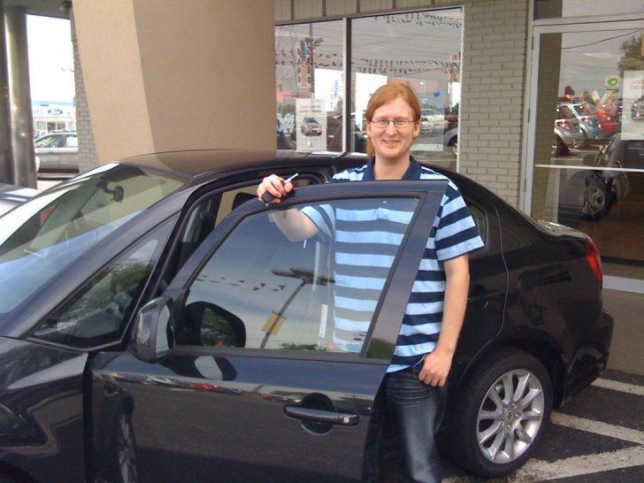 man getting new car