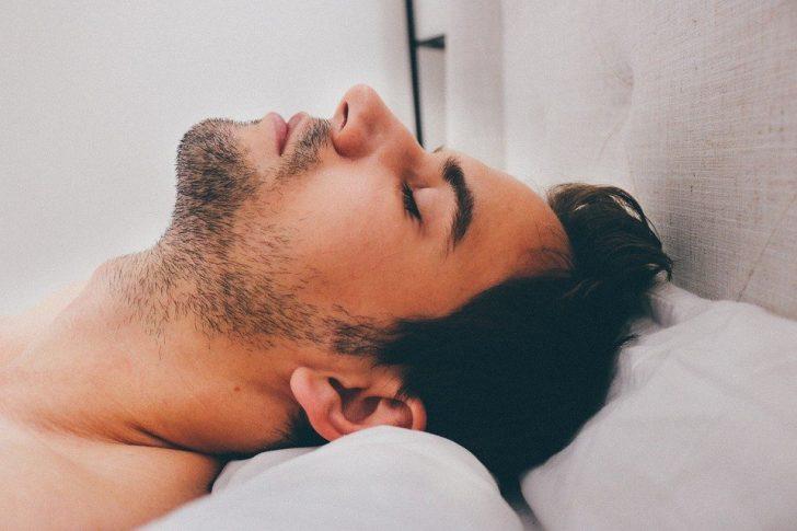 man laying on pillow