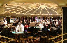 people gambling inside a casino in vegas