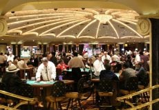 people gambling inside a casino in vegas
