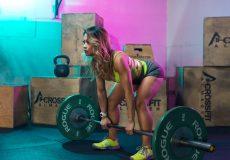 woman lifting rogue weights