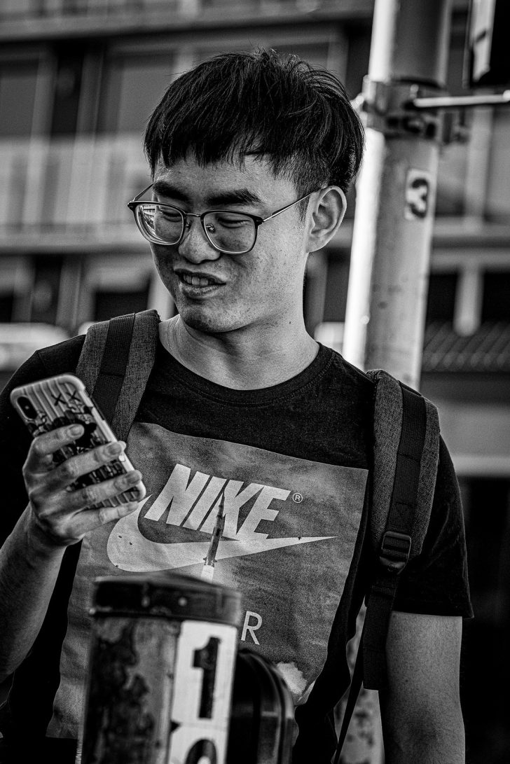 nerd looking at cellphone