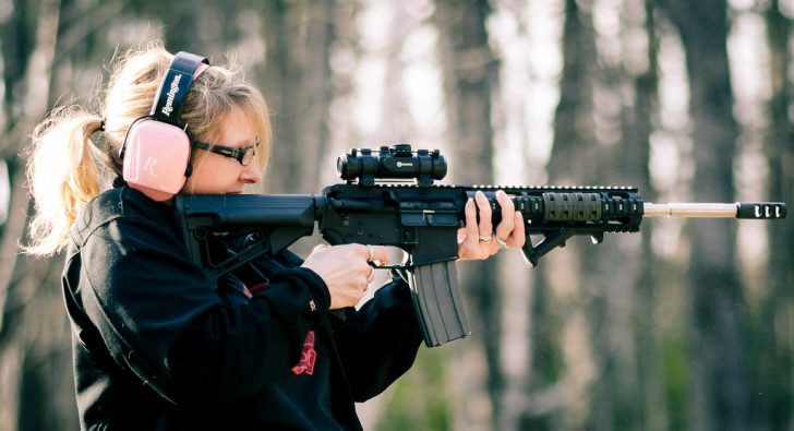 woman in pink firing ar15