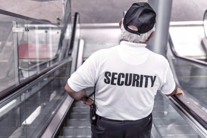 security guard on escalator