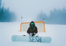 sesh woman on snowboard in the snow
