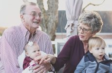 grandparents holding kids