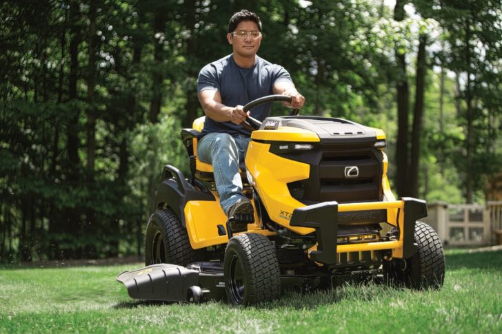 man driving lawn tractor