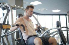 man using weight machine