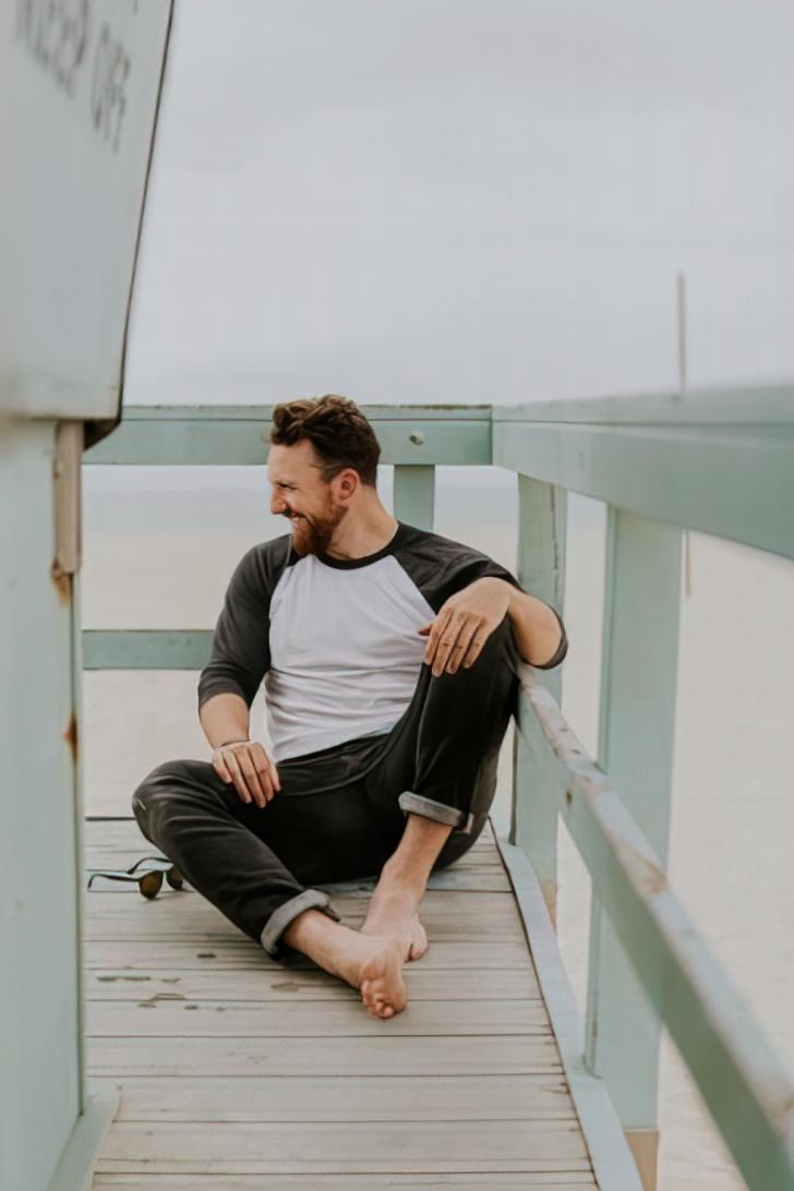 man sitting on dock