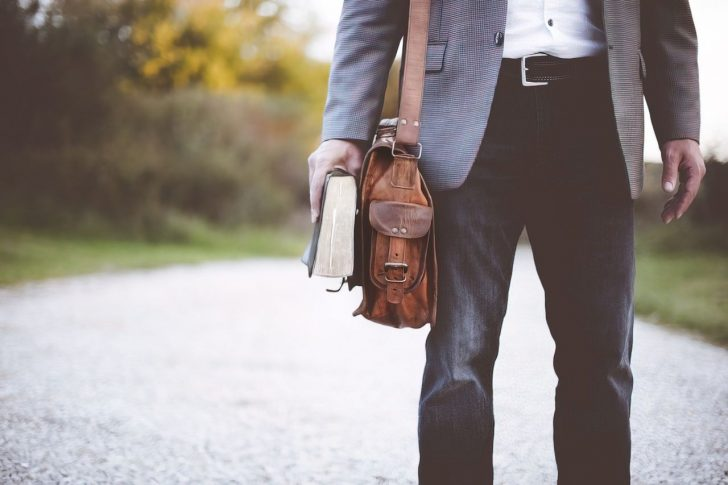 man with little bag upscaled