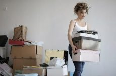 creepy woman moving boxes