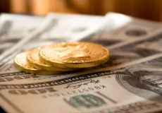 gold coins on cash