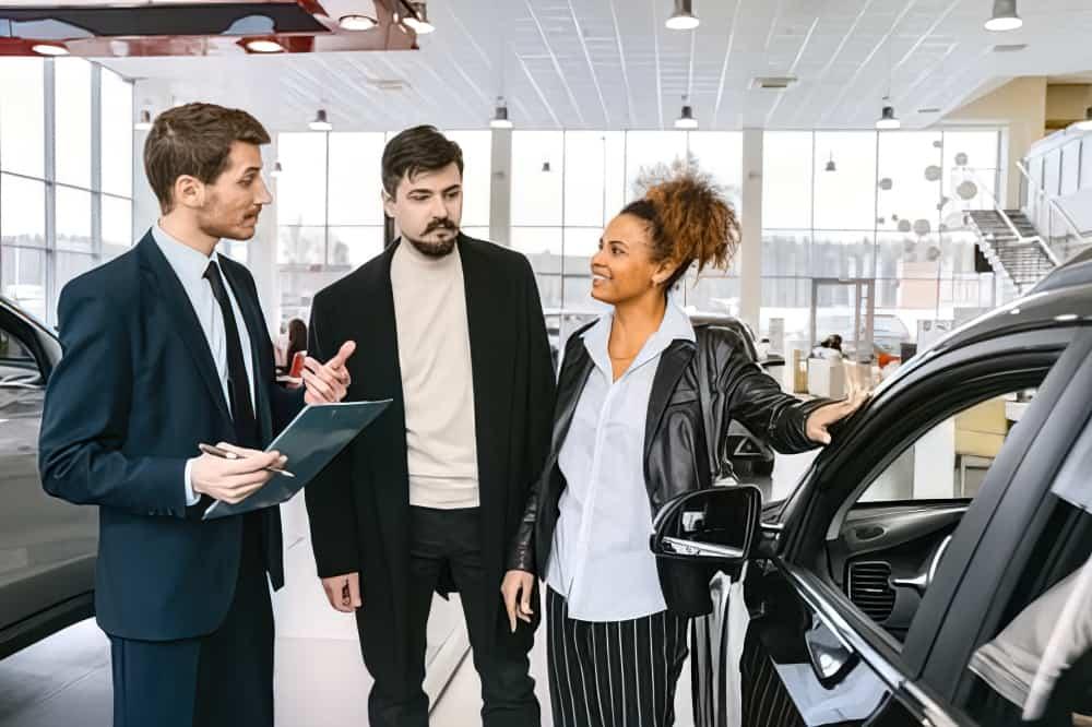 car salesman talking to people