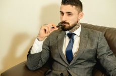 handsome man biting pen