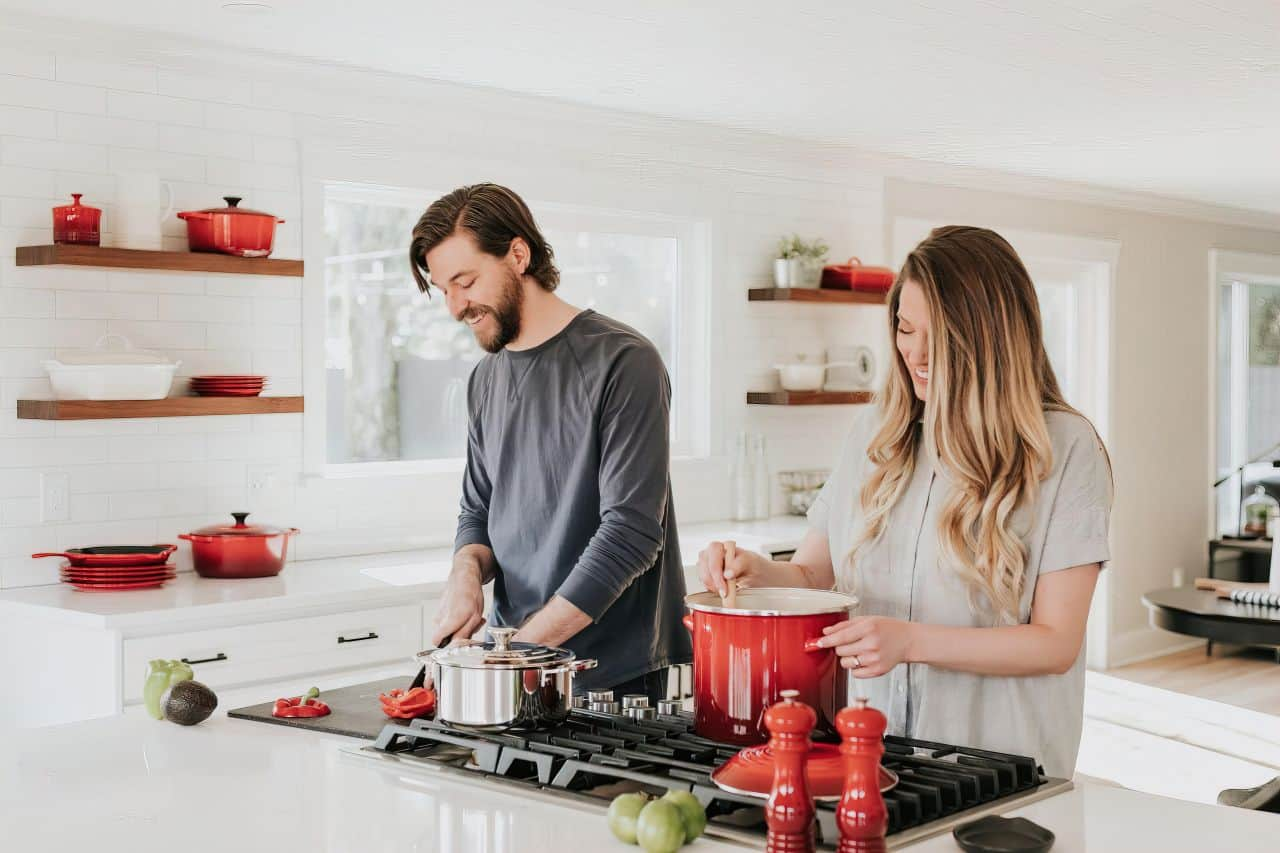 husband and wife cooking