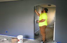 man painting his walls
