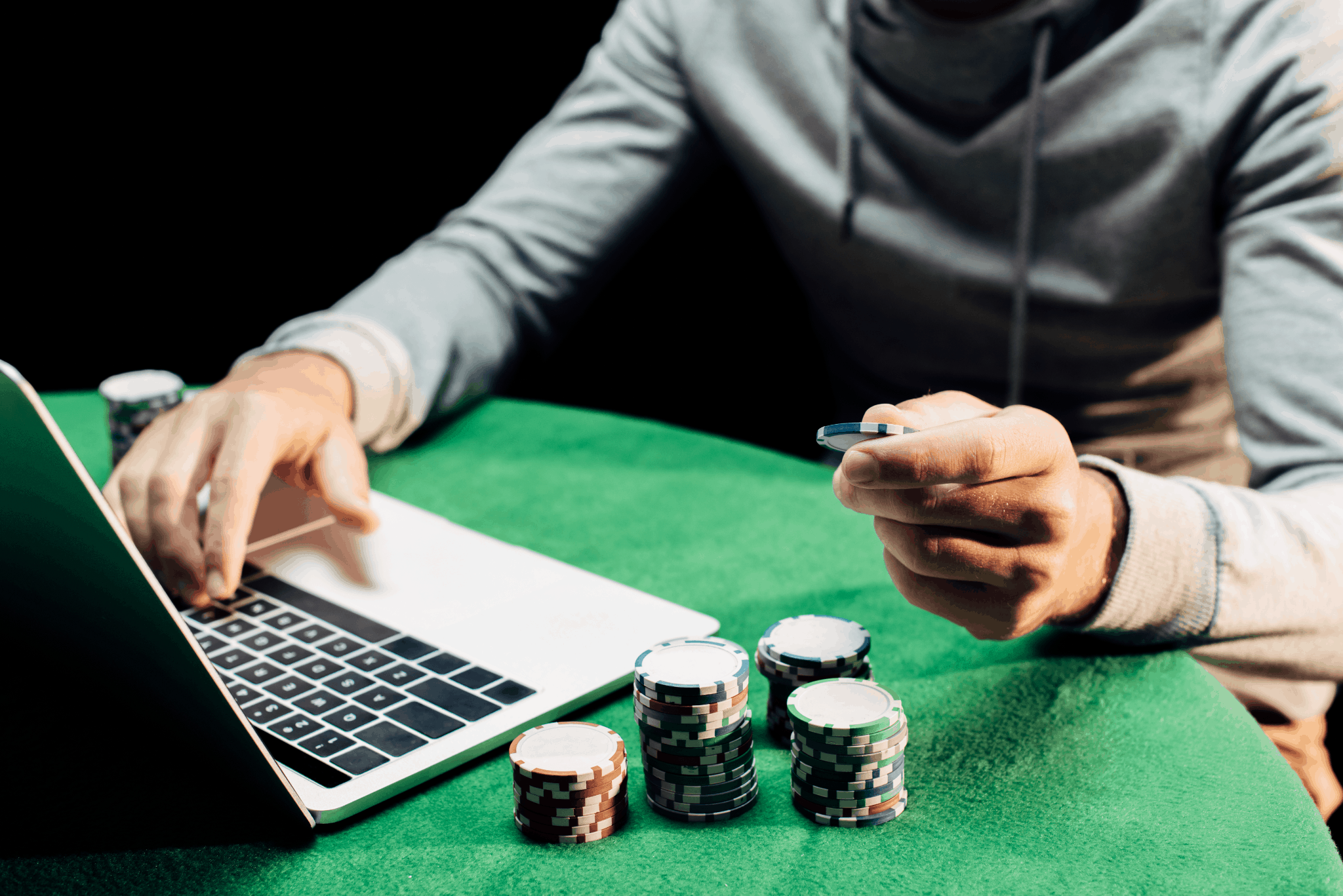 poker chips near laptop