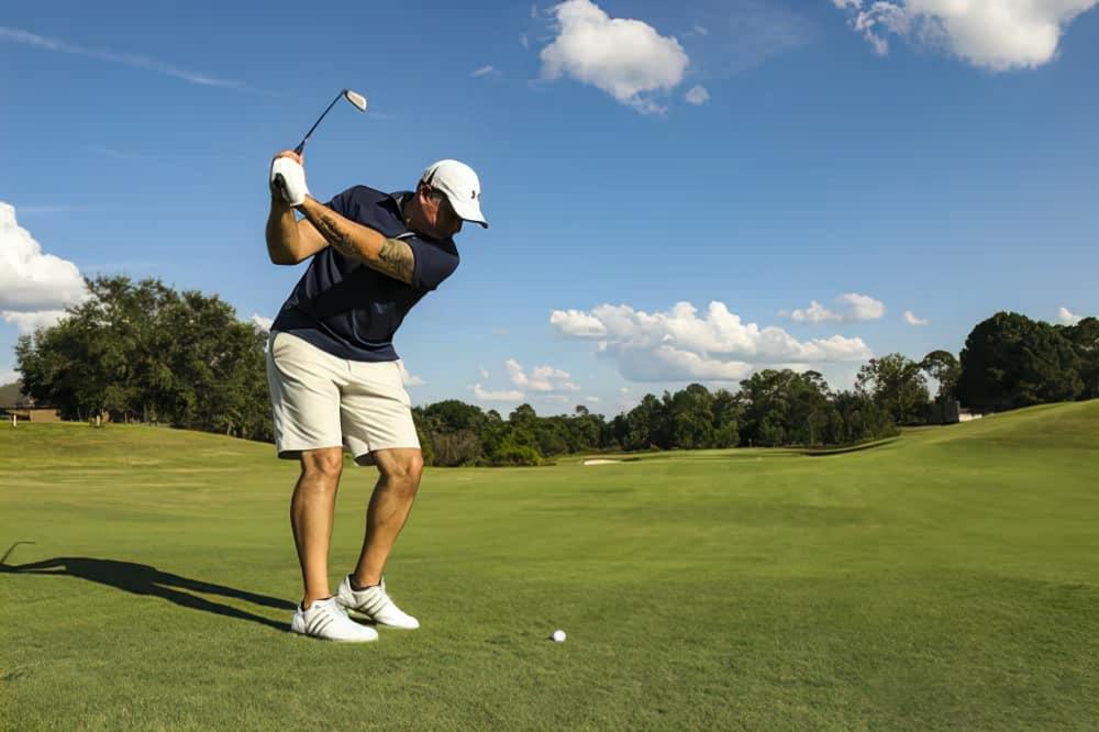 swinging golf club